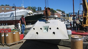 HMS 8000 Low Profile mooring is hoisted onto barge at Maine Maritime Academy.